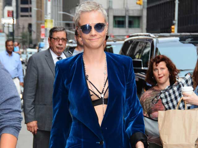 Cara Delevingne in a blue velvet suit