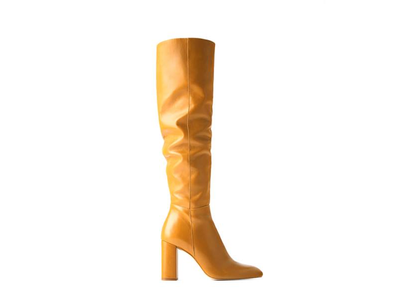 Yellow leather knee-high boots by Zara available at City Centre Deira