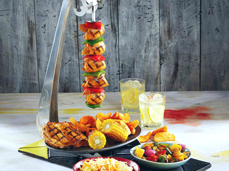 A chicken skewer and other dishes from Nando's